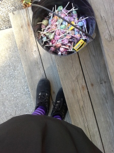 My striped tights, skirt, and black boots next to the candy I gave out.