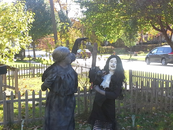 Me wearing my daughter's costume from last year, weeping angel, and attacking my daughter